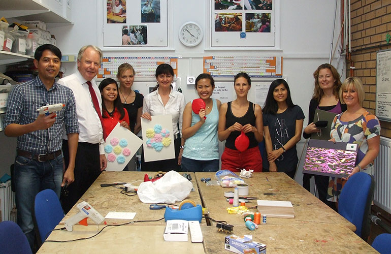 Photograph of volunteers in our workshop