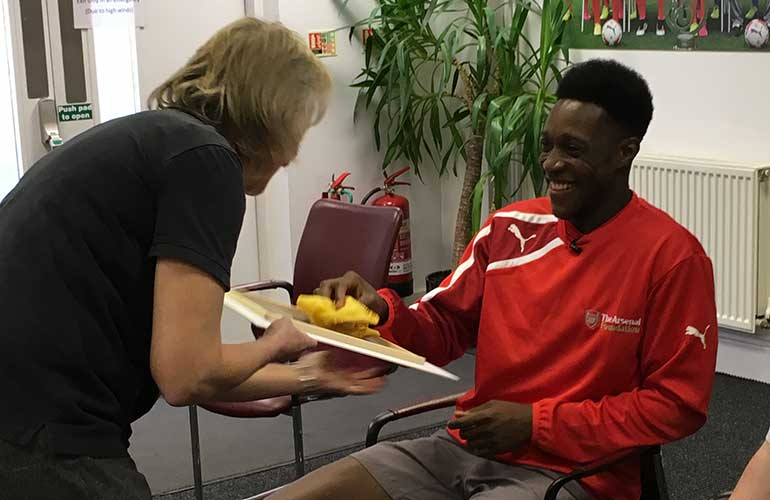 Photo of Danny Welbeck taking part in a storytelling session