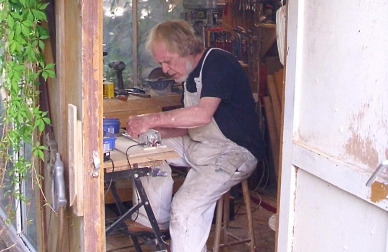 Photograph of Tony in his shed